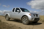 2014 Nissan Frontier King Cab PRO-4X 4WD in Brilliant Silver - Driving Front Right Three-quarter View