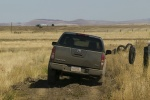 2015 Nissan Frontier Crew Cab PRO-4X 4WD in Night Armor - Driving Rear View