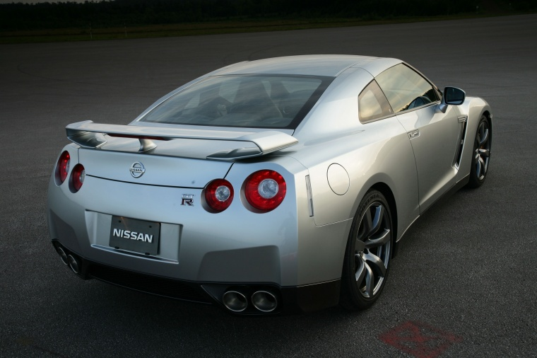 2010 Nissan GT-R Coupe in Super Silver 3-Coat Metallic from a rear right view