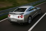 2010 Nissan GT-R Coupe in Super Silver 3-Coat Metallic - Driving Rear Right Three-quarter View