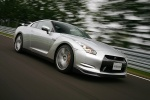 2010 Nissan GT-R Coupe in Super Silver 3-Coat Metallic - Driving Front Right Three-quarter View