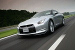 2010 Nissan GT-R Coupe in Super Silver 3-Coat Metallic - Driving Front Left Three-quarter View