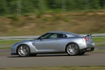 2010 Nissan GT-R Coupe in Super Silver 3-Coat Metallic - Driving Left Side View