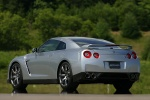 2010 Nissan GT-R Coupe in Super Silver 3-Coat Metallic - Static Rear Left Three-quarter View