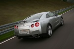 2010 Nissan GT-R Coupe in Super Silver 3-Coat Metallic - Driving Rear Right View