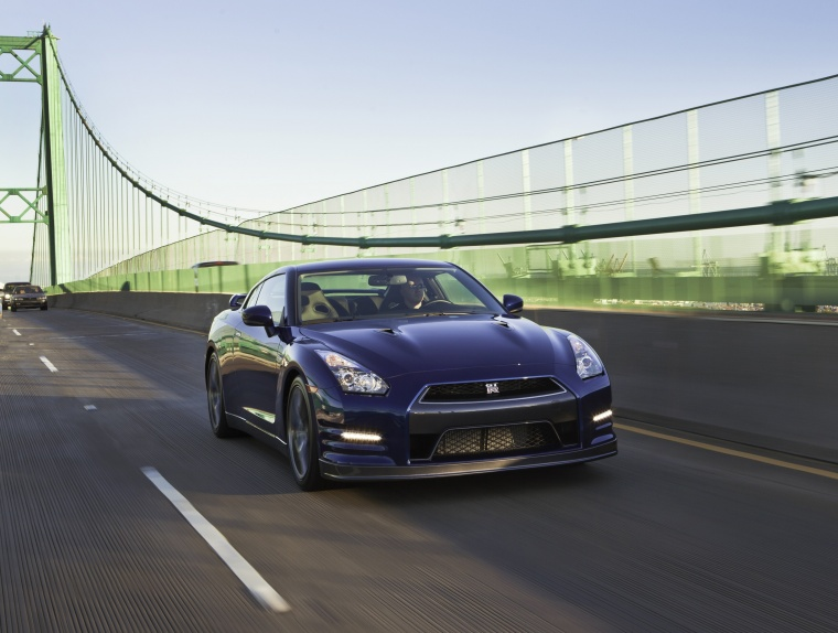 Driving 2014 Nissan GT-R Coupe in Deep Blue Pearl from a front right view