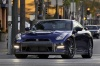 Driving 2014 Nissan GT-R Coupe in Deep Blue Pearl from a front left view