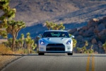 2014 Nissan GT-R Coupe in Pearl White - Driving Frontal View