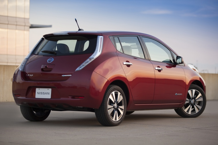2013 Nissan Leaf in Cayenne Red from a rear right three-quarter view