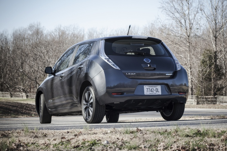 Driving 2013 Nissan Leaf in Metallic Slate from a rear left view