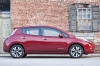 2014 Nissan Leaf in Cayenne Red from a side view