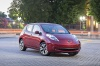 2014 Nissan Leaf in Cayenne Red from a front right three-quarter view
