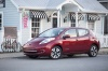 2014 Nissan Leaf in Cayenne Red from a front left three-quarter view