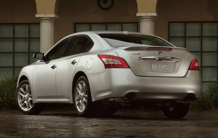 2010 Nissan Maxima in Radiant Silver from a rear left three-quarter view