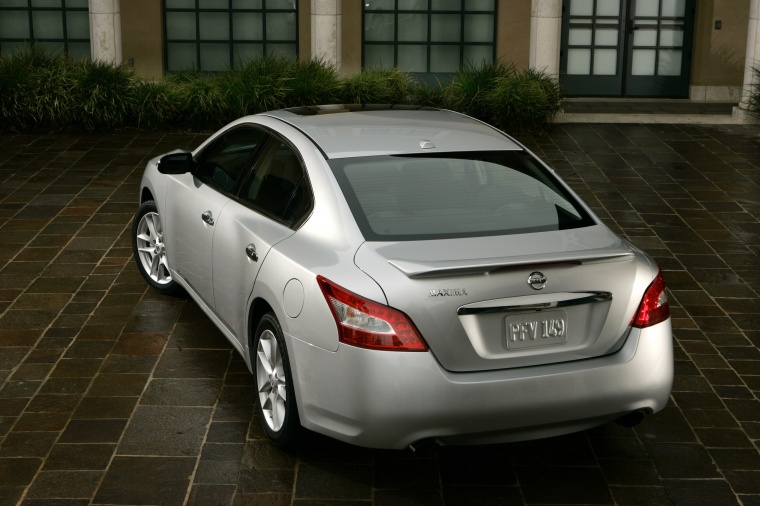 2010 Nissan Maxima in Radiant Silver from a rear left view