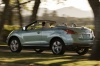 Driving 2013 Nissan Murano CrossCabriolet from a rear left three-quarter view