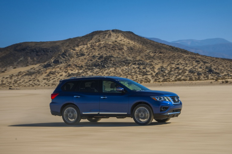 Driving 2020 Nissan Pathfinder Platinum 4WD in Caspian Blue Metallic from a front right three-quarter view