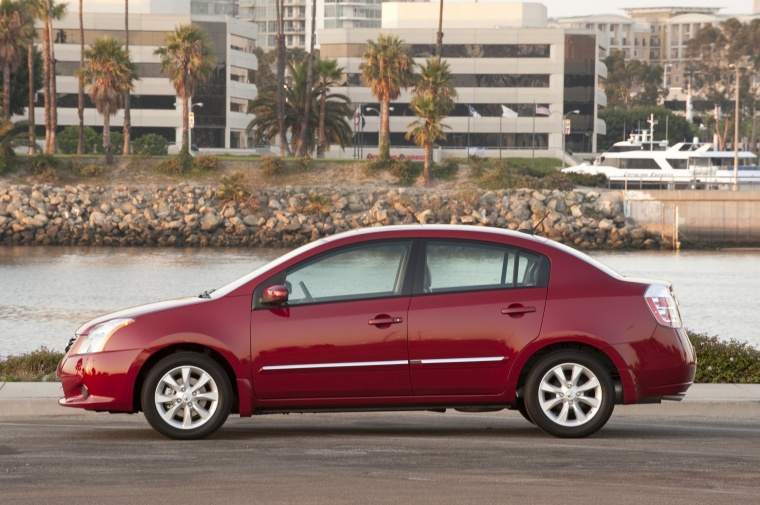 2010 Nissan Sentra SL Sedan in Red Brick Pearl from a left side view