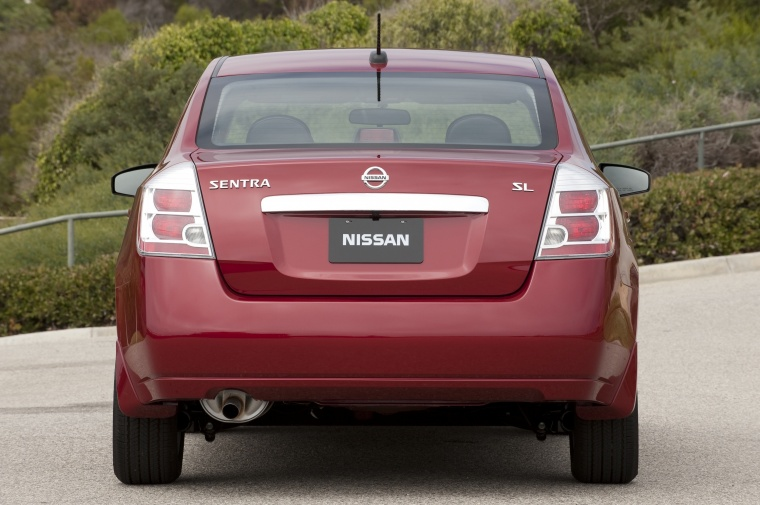 2010 Nissan Sentra SL Sedan in Red Brick Pearl from a rear view