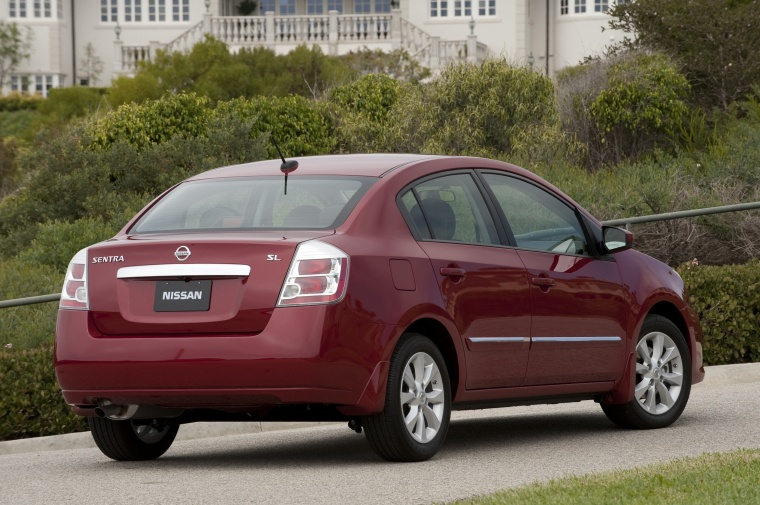 2010 Nissan Sentra SL Sedan in Red Brick Pearl from a rear right view