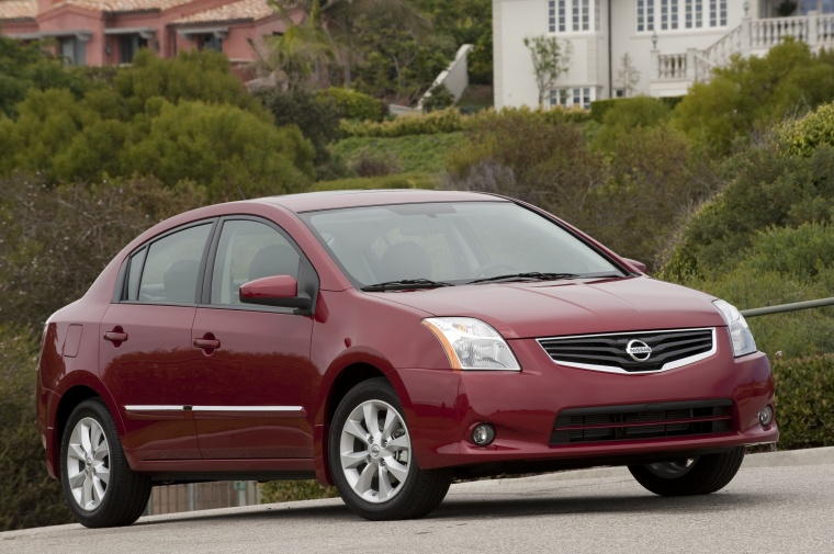 2010 Nissan Sentra SL Sedan in Red Brick Pearl from a front right three-quarter view