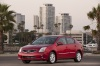 2010 Nissan Sentra SL Sedan in Red Brick Pearl from a front left view