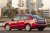 2010 Nissan Sentra SL Sedan in Red Brick Pearl from a rear left three-quarter view