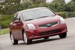 2010 Nissan Sentra SL Sedan in Red Brick Pearl - Driving Front Right View