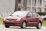 2010 Nissan Sentra SL Sedan in Red Brick Pearl - Driving Front Left Three-quarter View