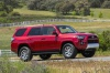 Driving 2020 Toyota 4Runner TRD Off Road in Barcelona Red Metallic from a front right three-quarter view