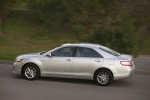 2010 Toyota Camry Hybrid in Classic Silver Metallic - Driving Left Rear View