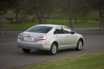 2011 Toyota Camry Hybrid in Classic Silver Metallic - Driving Rear Three-quarter View