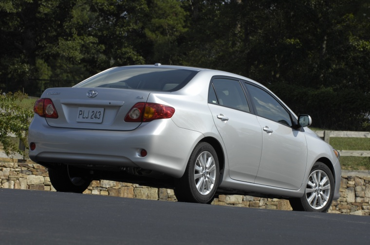 2010 Toyota Corolla S in Classic Silver Metallic from a rear right three-quarter view