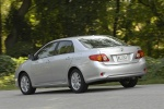 2010 Toyota Corolla XLE in Classic Silver Metallic - Driving Rear Left Three-quarter View