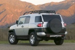 2010 Toyota FJ Cruiser rear left three-quarter in Silver Fresco Metallic - Static Orientation View