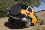 2010 Toyota FJ Cruiser in Sun Fusion - Driving Rear Right View