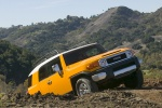 2010 Toyota FJ Cruiser in Sun Fusion - Driving Front Right Three-quarter View