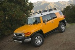 2010 Toyota FJ Cruiser in Sun Fusion - Driving Front Left Three-quarter View