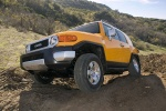 2010 Toyota FJ Cruiser in Sun Fusion - Driving Front Left View