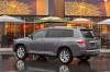 2013 Toyota Highlander Hybrid in Magnetic Gray Metallic from a rear left three-quarter view