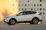 2016 Toyota RAV4 Hybrid XLE AWD in Super White - Driving Side View