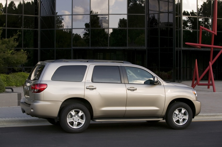 2010 Toyota Sequoia in Sandy Beach Metallic from a rear side view
