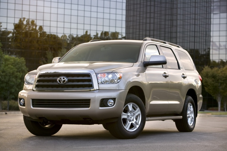 2014 Toyota Sequoia in Sandy Beach Metallic from a front left three-quarter view