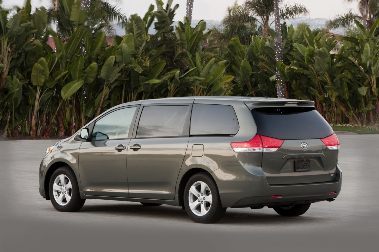 2012 Toyota Sienna LE in Predawn Gray Mica from a rear left three-quarter view