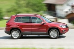2012 Volkswagen Tiguan in Wild Cherry Metallic - Driving Right Side View