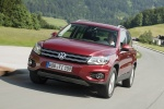2012 Volkswagen Tiguan in Wild Cherry Metallic - Driving Front Left View