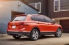 2018 Volkswagen Tiguan SEL in Habanero Orange Metallic from a rear right three-quarter view