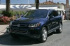 2012 Volkswagen Touareg Hybrid in Night Blue Metallic from a front left three-quarter view