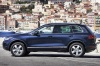 2012 Volkswagen Touareg Hybrid in Night Blue Metallic from a side view