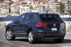 2012 Volkswagen Touareg Hybrid in Night Blue Metallic from a rear left three-quarter view